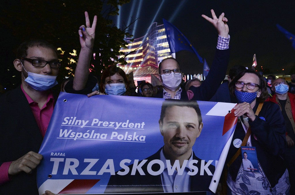 Supporters of presidential candidate Rafal Trzaskowski gather in front of Polish Television headquarters before the candidates debate held for the upc...