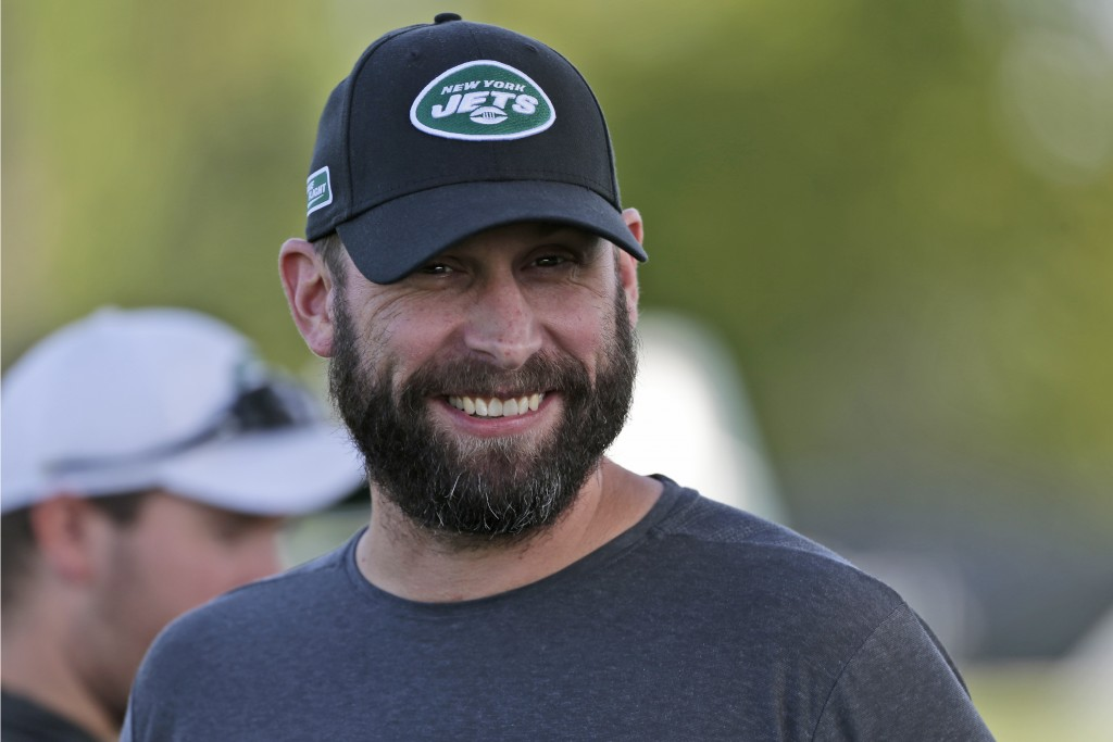 FILE - In this Thursday, July 25, 2019, file photo, New York Jets head coach Adam Gase smiles during practice at the NFL football team's training camp...
