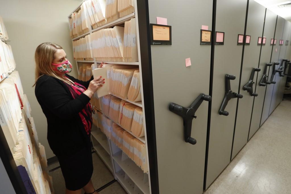 Jennifer Gottschalk, environmental health supervisor of the Toledo-Lucas County Health Department, retrieves a file in Toledo, Ohio, on Wednesday, Jun...