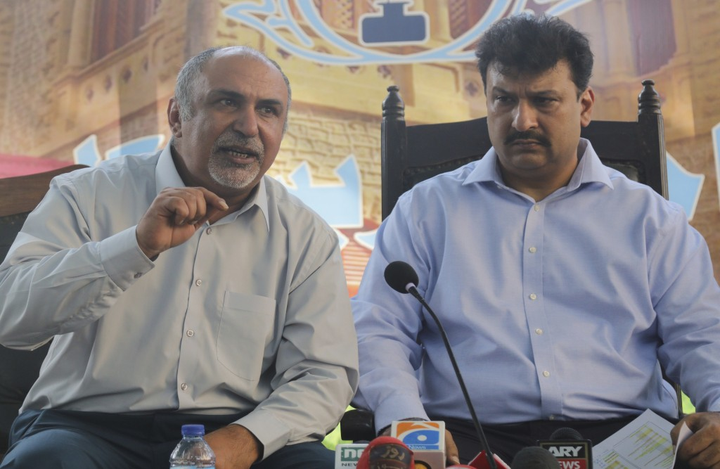 Secretary General Maqsood Bijrani, left, and Captain Chaudhry Salman, President of Pakistan Airlines Pilots' Association address a news conference in ...