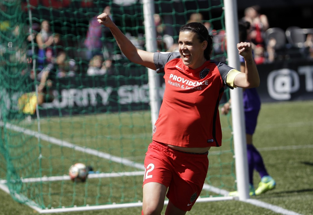 FILE - In this April 15, 2017, file photo, Portland Thorns forward Christine Sinclair celebrates scoring a goal during the second half of their NWSL s...