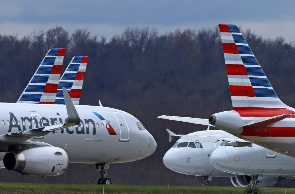 FILE - In this March 31, 2020 file photo American Airlines planes are parked at Pittsburgh International Airport in Imperial, Pa.  There will be no mo...