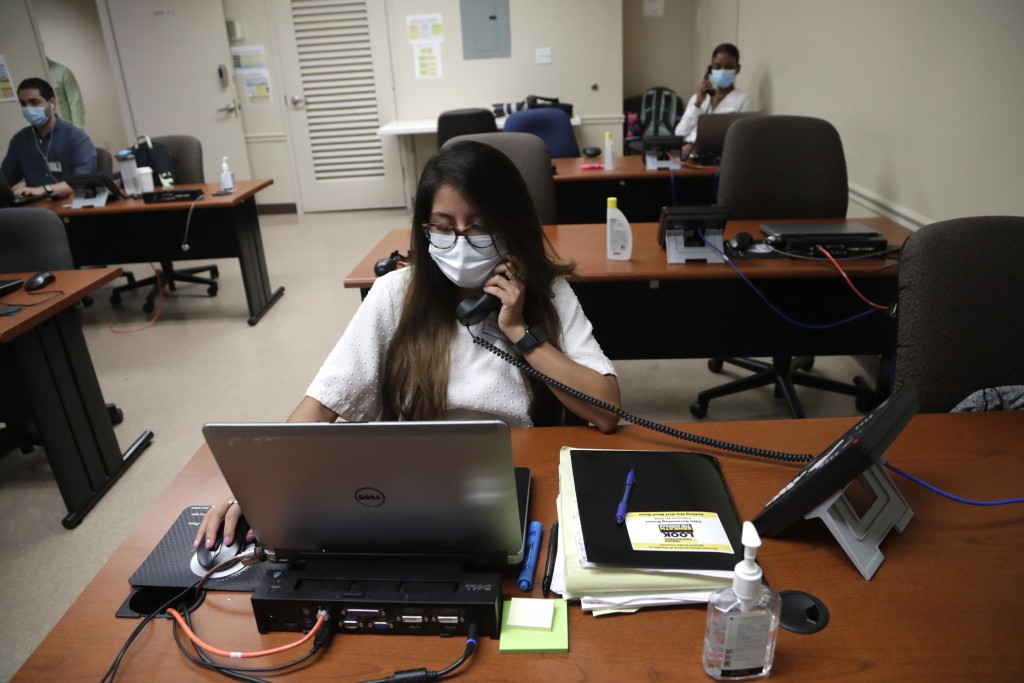 FILE - In this Wednesday, May 13, 2020, file photo, Maria Fernanda works on contact tracing at the Florida Department of Health in Miami-Dade County, ...