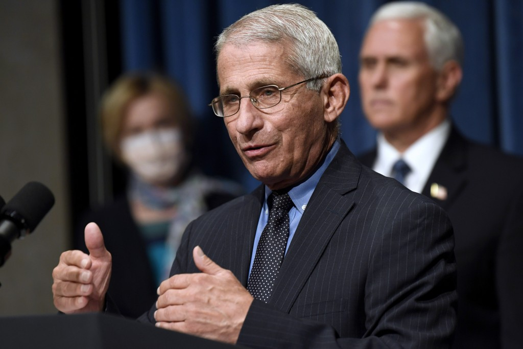 Director of the National Institute of Allergy and Infectious Diseases Dr. Anthony Fauci, center, speaks as Vice President Mike Pence, right, and Dr. D...