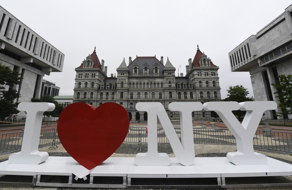 "FILE - In this Tuesday, June 18, 2019, file photo, a new promotional ""I Love NY"" sign sits in the Empire State Plaza for installation in front of the ..."
