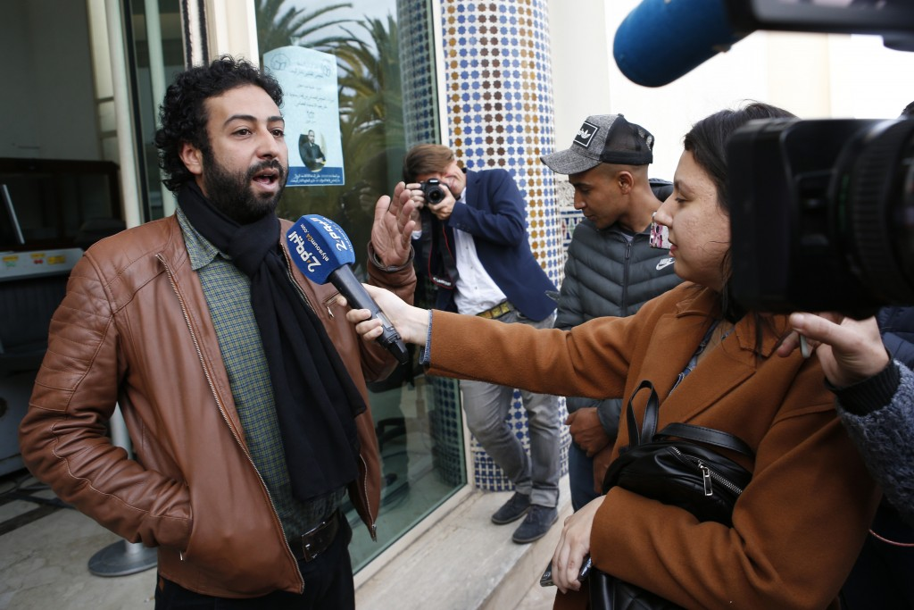 FILE - In this March 5, 2020 file photo, journalist and activist Omar Radi speaks to the media after his hearing at the Casablanca Courthouse, In Casa...