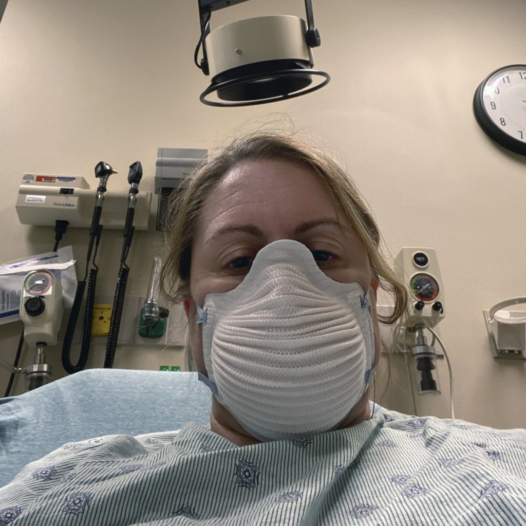 This Tuesday, March 24, 2020, photo provided by Jennifer Gottschalk shows her getting tested for COVID-19 in a Toledo, Ohio, hospital. As the environm...