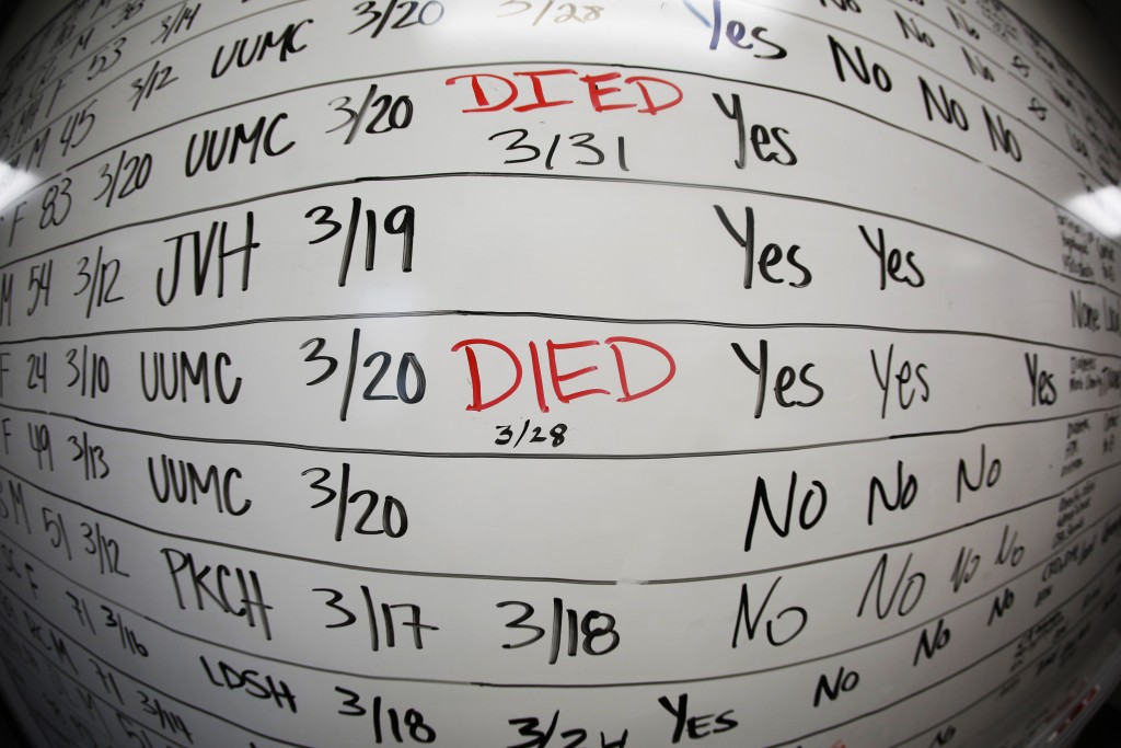 FILE - This Wednesday, May 13, 2020, file photo made with a fisheye lens shows a list of the confirmed COVID-19 cases in Salt Lake County early in the...