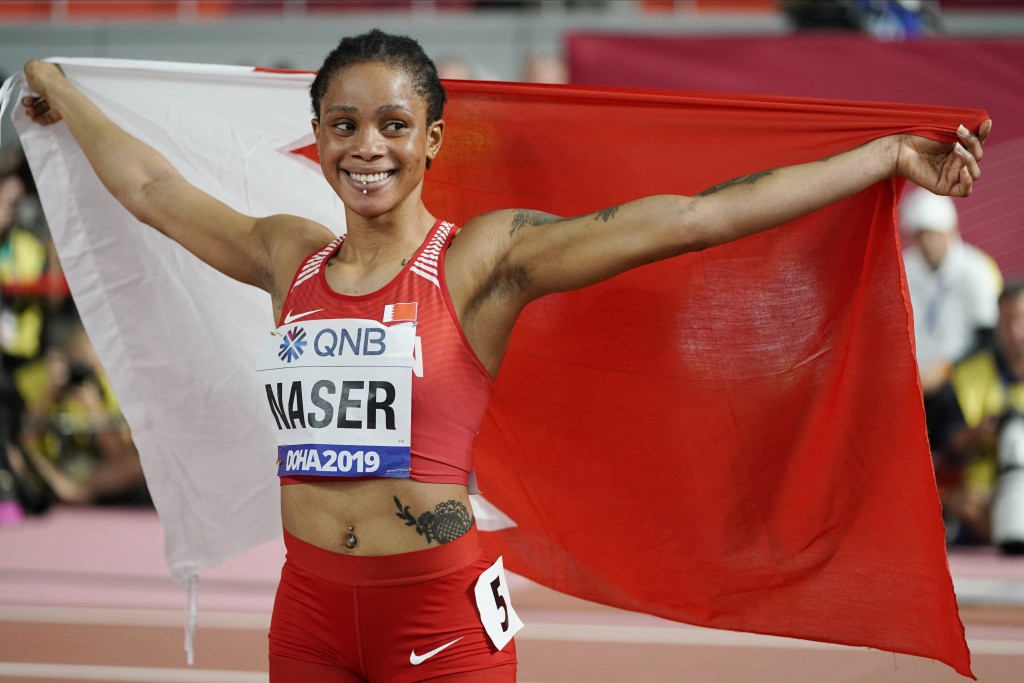 FILE - In this Oct. 3, 2019, file photo, Salwa Eid Naser, of Bahrain, celebrates after winning gold in the women's 400-meter final at the World Athlet...