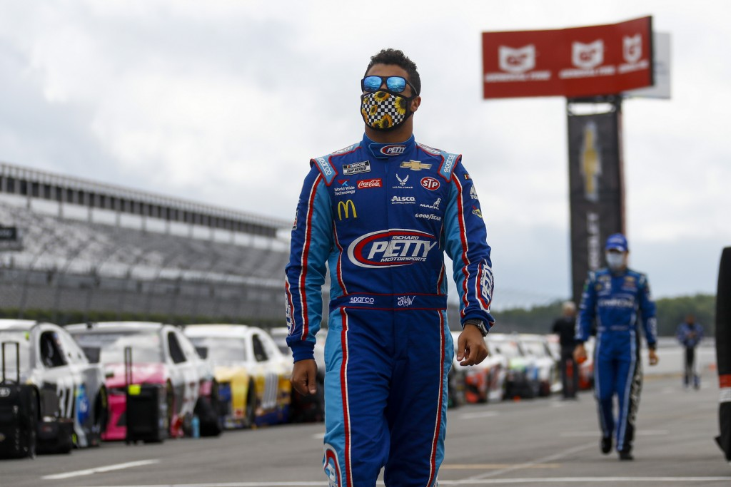 Bubba Wallace walks down pit row down before the start of a NASCAR Cup Series auto race at Pocono Raceway, Saturday, June 27, 2020, in Long Pond, Pa. ...