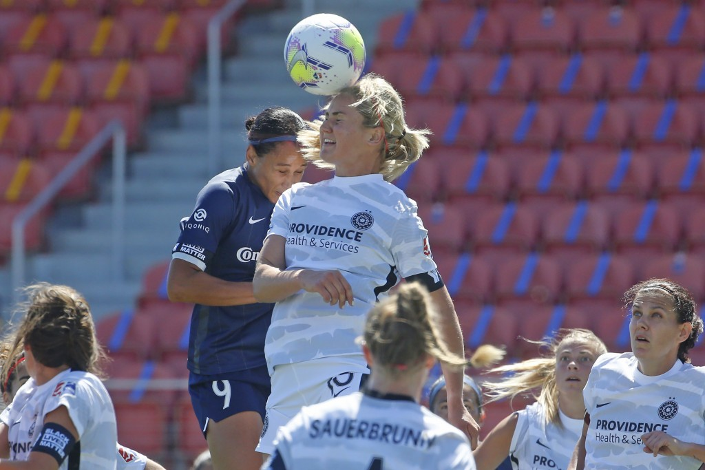 North Carolina Courage forward Lynn Williams (9) and Portland Thorns FC midfielder Lindsey Horan (10) battle for the ball during the first half of an ...