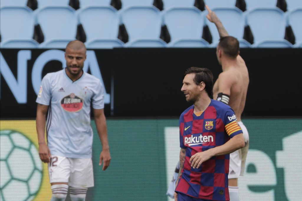 Barcelona's Lionel Messi, second right, reacts after Celta Vigo's Iago Aspas scored his side's second goal during a Spanish La Liga soccer match betwe...