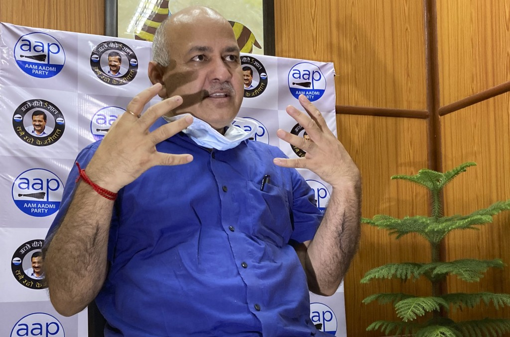 Acting health minister of India's capital New Delhi Manish Sisodia speaks during an interview with The Associated Press in New Delhi, India, Saturday,...