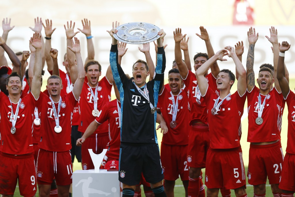 Munich's team captain Manuel Neuer lifts the trophy after  the German Bundesliga soccer match between VfL Wolfsburg and FC Bayern Munich in Wolfsburg,...