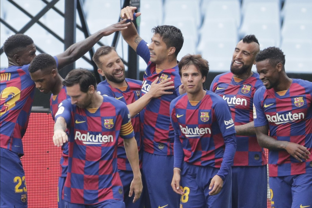 Barcelona's Luis Suarez, center, celebrates after scoring the opening goal during a Spanish La Liga soccer match between RC Celta and Barcelona at the...