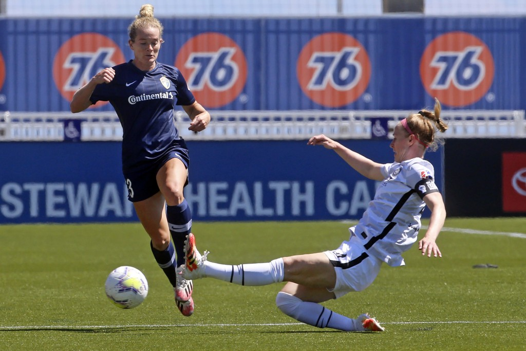 North Carolina Courage forward Kristen Hamilton (23) drives as Portland Thorns FC defender Becky Sauerbrunn (4) slides in with a challenge during the ...