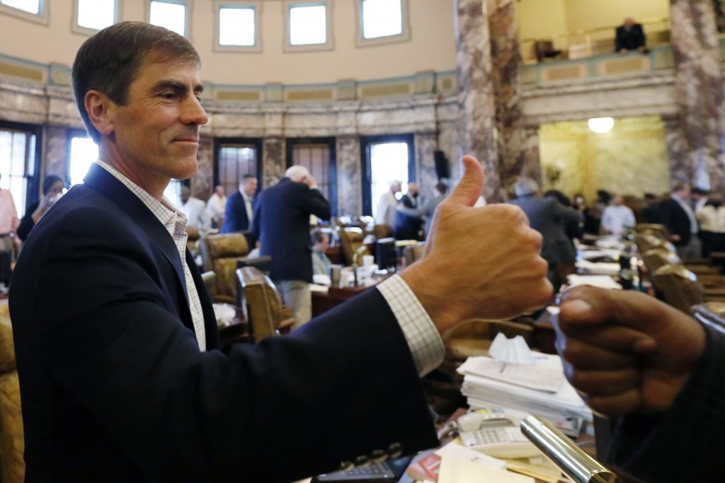 Republican Sen. Briggs Hopson, of Vicksburg, is congratulated for successfully navigating a resolution to suspend the rules and vote to change the sta...