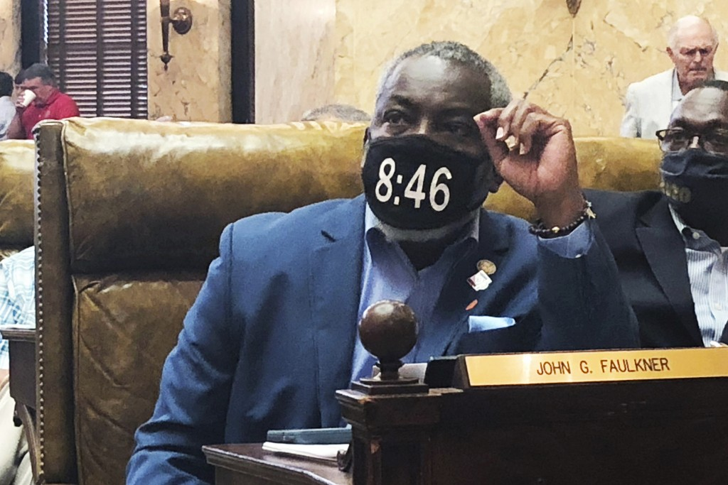 Mississippi state Rep. John Faulkner, D-Holly Springs, wears a mask in honor of George Floyd on Saturday, June 27, 2020, in the House chamber of the M...