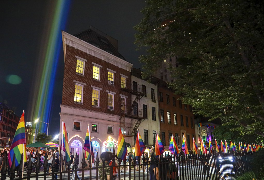 A rainbow light display illuminates the night sky in the West Village near The Stonewall Inn, birthplace of the gay rights movement, Saturday, June 27...
