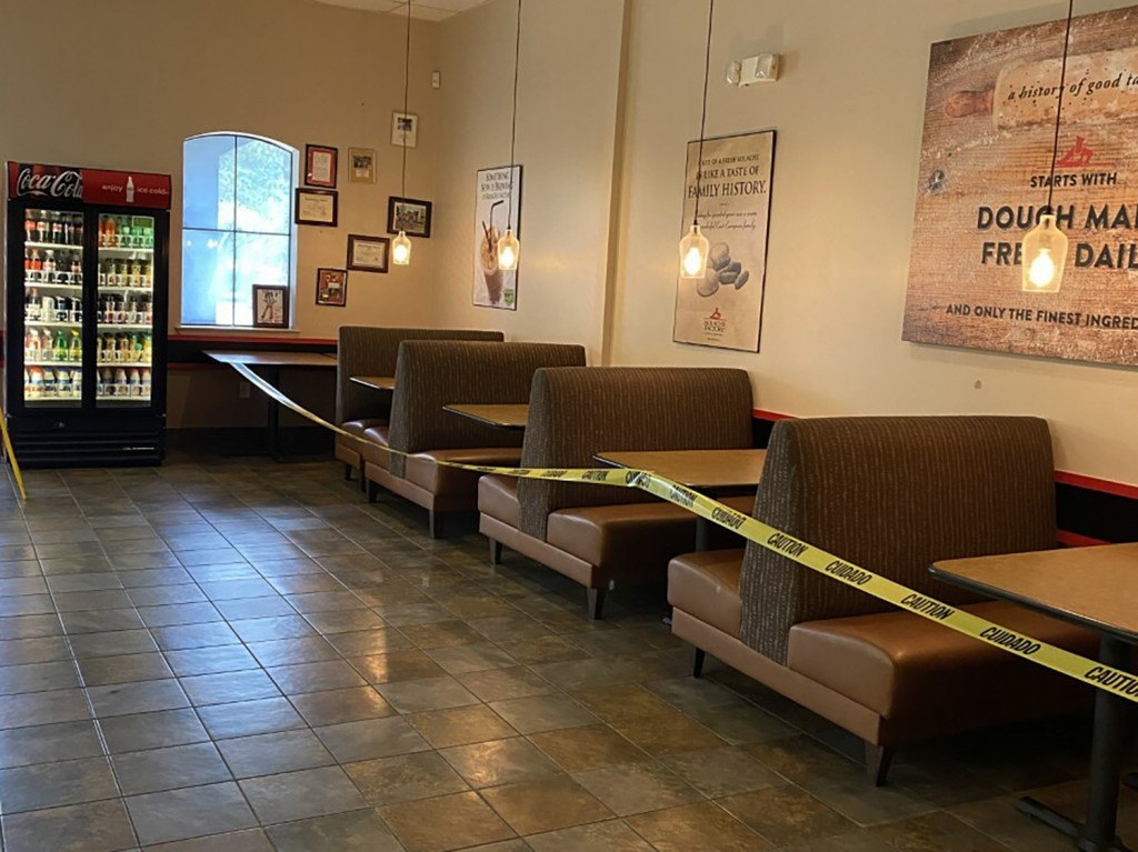 This May 16, 2020 photo provided by Kolache Factory shows the dining area of Kolache Factory in Houston.  Businesses reopening across states after mon...