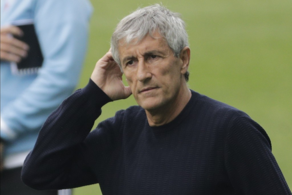Barcelona's head coach Quique Setien gestures after the Spanish La Liga soccer match between RC Celta and Barcelona at the Balaidos stadium in Vigo, S...