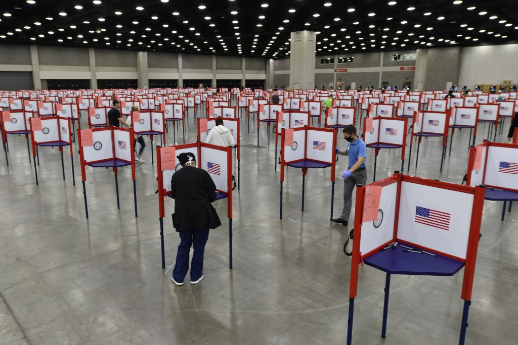 FILE - In this June 23, 2020, file photo voting stations are set up in the South Wing of the Kentucky Exposition Center for voters to cast their ballo...