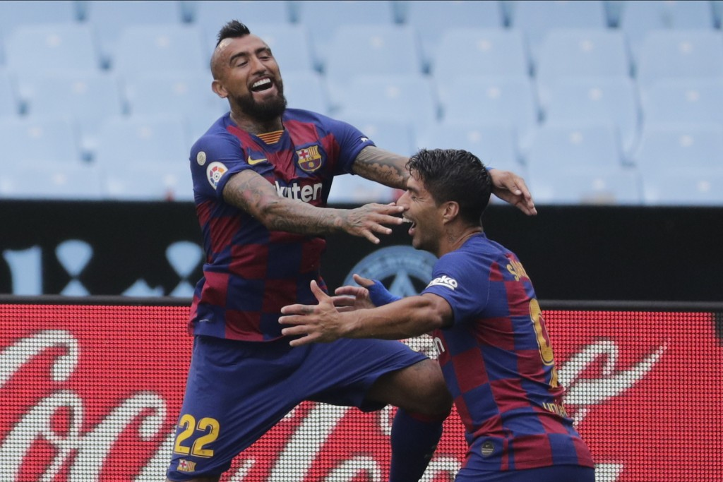 Barcelona's Luis Suarez, right, celebrates after with his teammate Barcelona's Arturo Vidal the opening goal during a Spanish La Liga soccer match bet...
