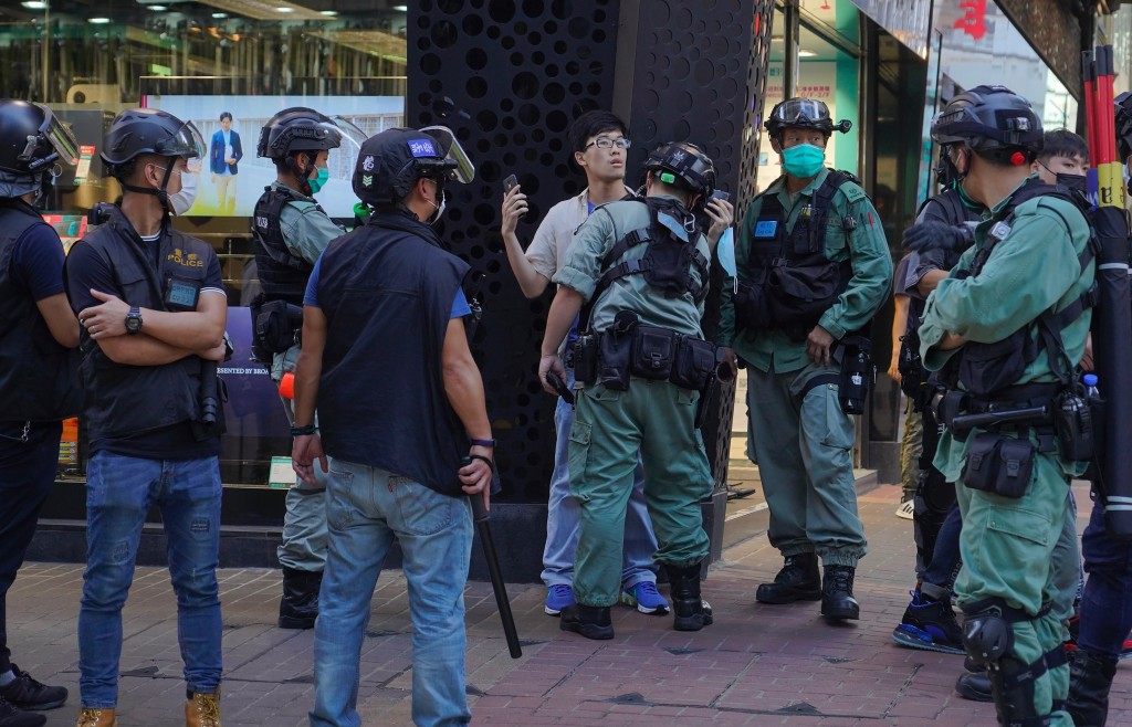 Police detain a person during a pro-democracy rally supporting human rights and to protest against Beijing's national security law in Hong Kong, Sunda...
