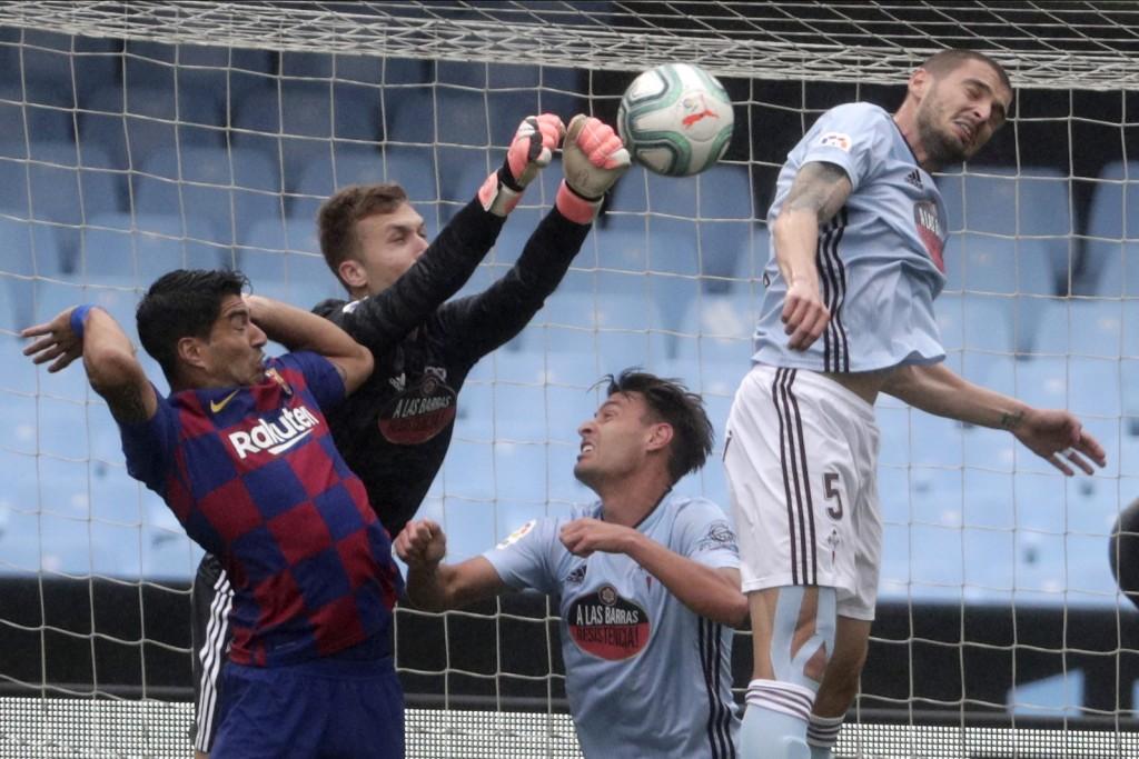 Celta Vigo's goalkeeper Ruben Blanco, second left, clears a ball during a Spanish La Liga soccer match between RC Celta and Barcelona at the Balaidos ...