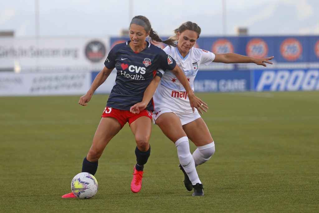 Chicago Red Stars' Bianca St. Georges, right, battles with Washington Spirit forward Ashley Hatch (33) during the first half of an NWSL Challenge Cup ...