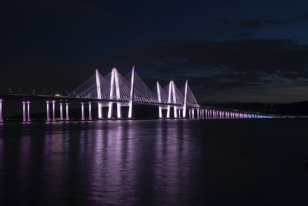 In this June 26, 2020 photo, provided by the Office of N.Y. Governor Andrew M. Cuomo, the Governor Mario M. Cuomo Bridge is shown lit in colors of Tra...