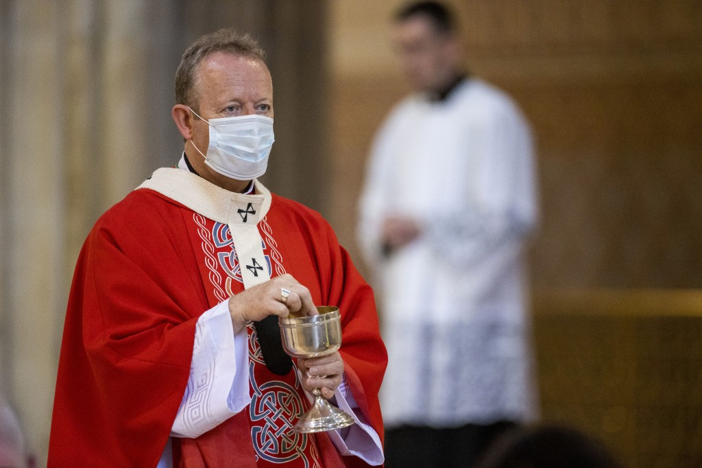 Eamon Martin, Archbishop of Armagh and the Primate of All Ireland, wears a face mask during holy communion, during Mass at St Patrick's Catholic Cathe...
