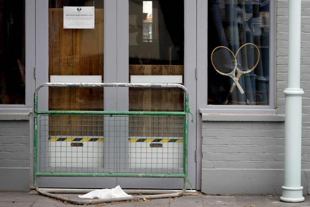 Two tennis racquets propped in the window of a closed pub in Wimbledon in London, Monday, June 29, 2020. The 2020 Wimbledon Tennis Championships, due ...