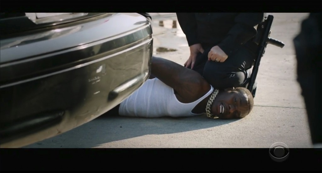 "In this video grab issued Sunday, June 28, 2020, by BET, rapper DaBaby performs ""Rockstar"" as an actor playing a police officer presses his knee on Da..."