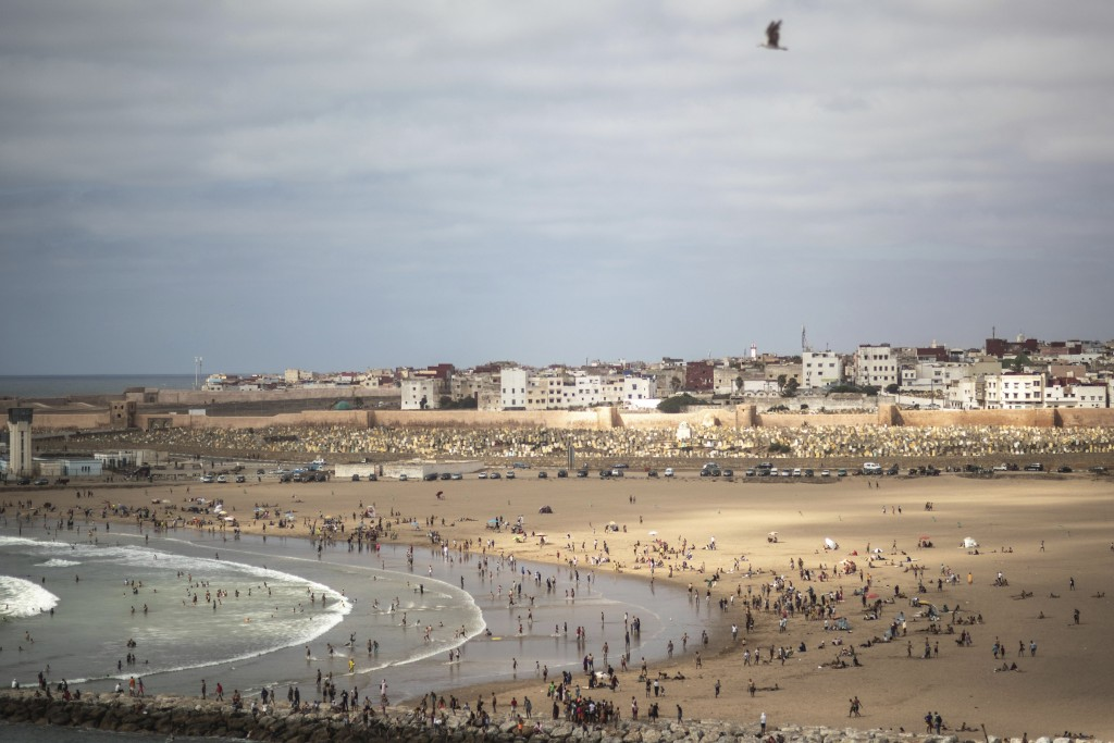 People gather at a reopened beach on the first weekend after lockdown measures were lifted in Sale, Morocco, Friday, June 26, 2020. Moroccans are re-e...