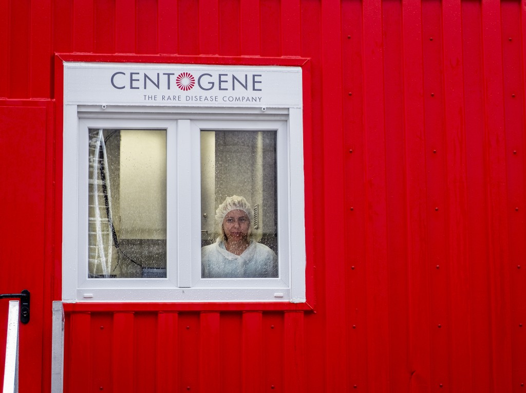 An employee of Centogene looks out of a laboratory container at the airport in Frankfurt, Germany, Monday, June 29, 2020. In the future, people will b...