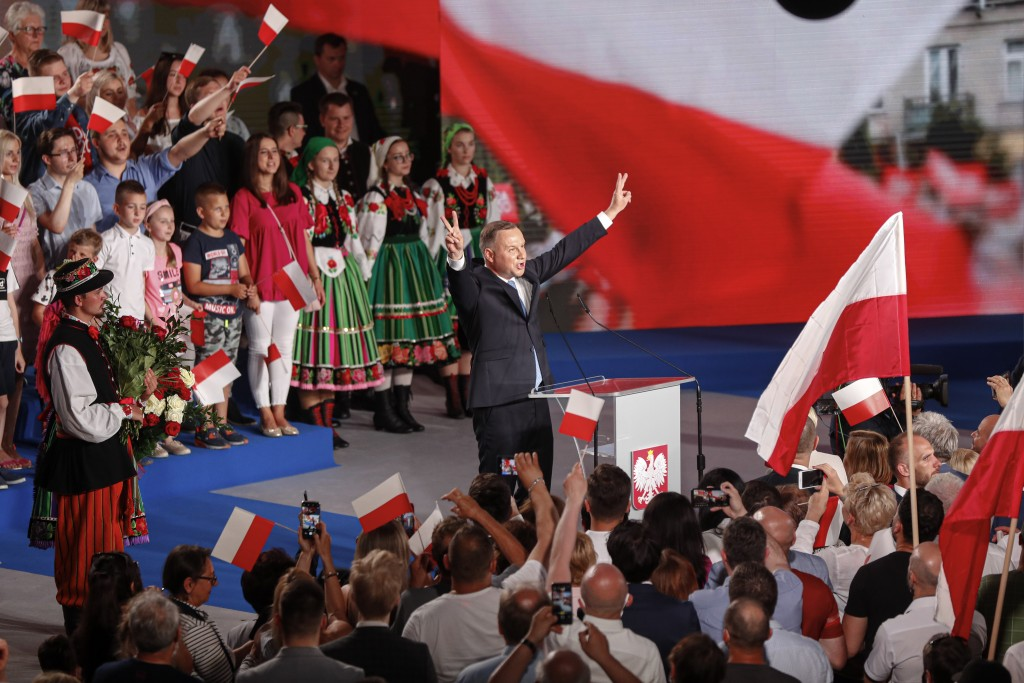 President Andrzej Duda flashes victory signs after voting ended in the presidential election in Lowicz, Poland, Sunday, June 28, 2020. The election wi...