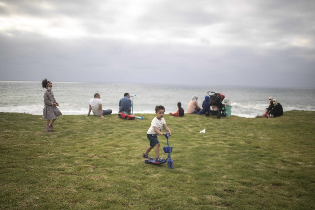 Families gather at a beach after lockdown measures were lifted in Rabat, Morocco, Thursday, June 25, 2020. Moroccans are re-experiencing a taste of th...