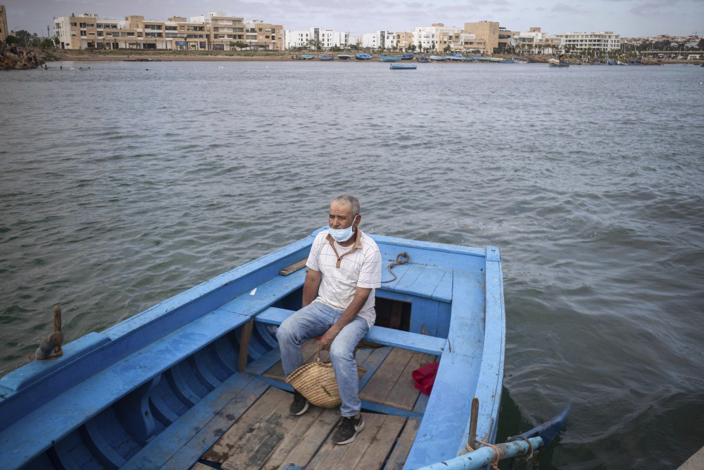 A man crosses by boat from Rabat to Sale after lockdown measures were lifted, in Morocco, Friday, June 26, 2020. Moroccans are re-experiencing a taste...