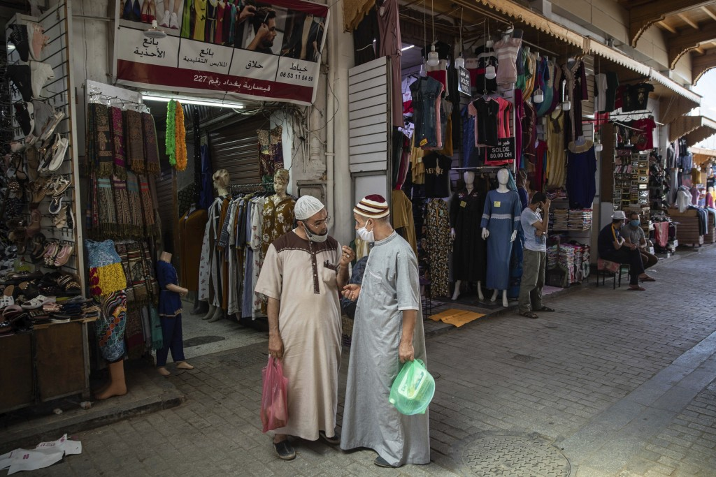 People wear face masks to prevent the spread of Coronavirus in the reopened Medina of Rabat after lockdown measures were lifted in Rabat, Morocco, Fri...
