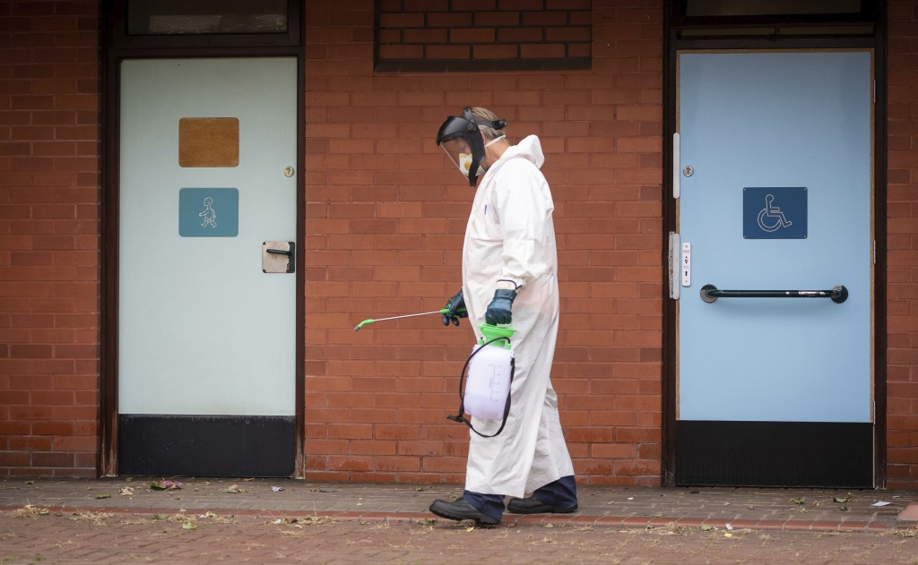 A worker for Leicester City Council disinfects public toilets in Leicester, England, Monday June 29, 2020. The central England city of Leicester is wa...