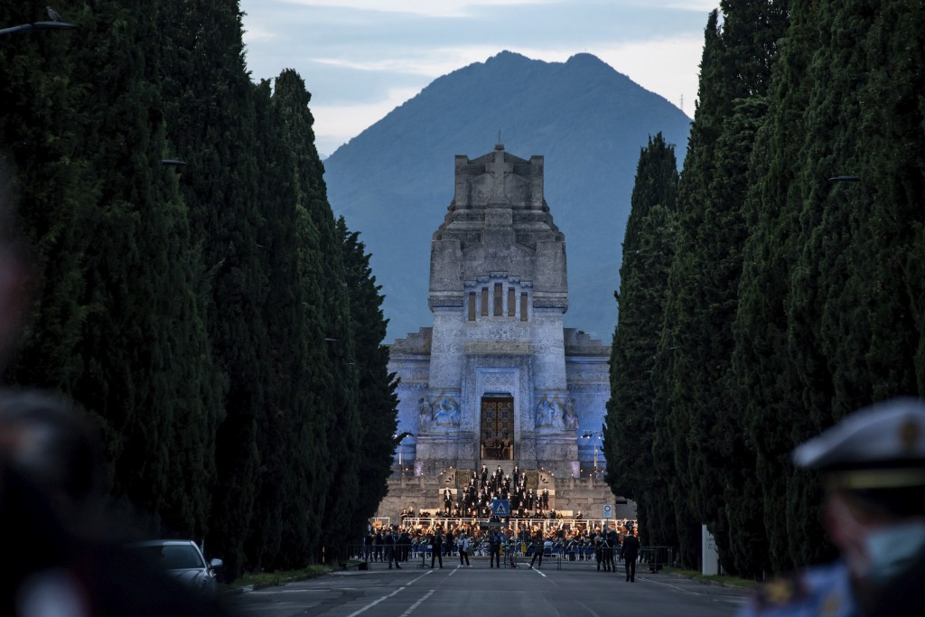 Musicians perform in front of the Bergamo cemetery, Italy, Sunday, June 28, 2020. Italy bid farewell to its coronavirus dead on Sunday with a haunting...