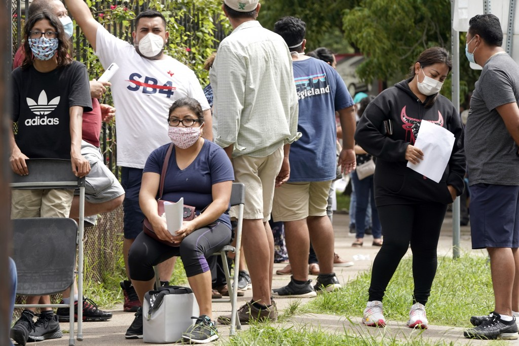 People wait in line at a free COVID-19 testing site provided by United Memorial Medical Center, at the Mexican Consulate, Sunday, June 28, 2020, in Ho...
