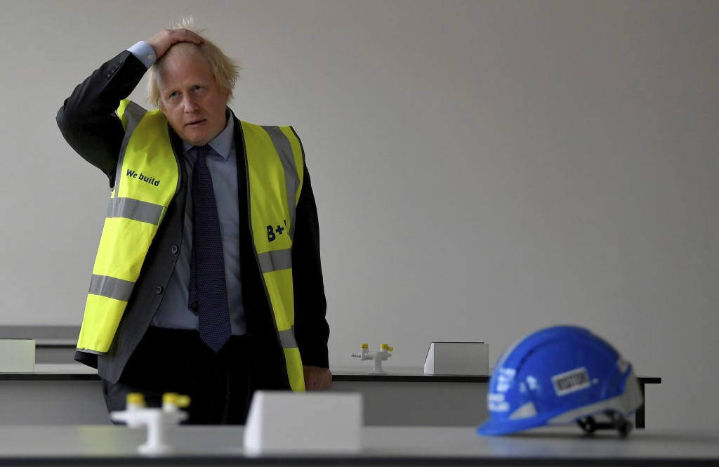 Britain's Prime Minister Boris Johnson in a science room under construction during a visit to the construction site of Ealing Fields High School in we...