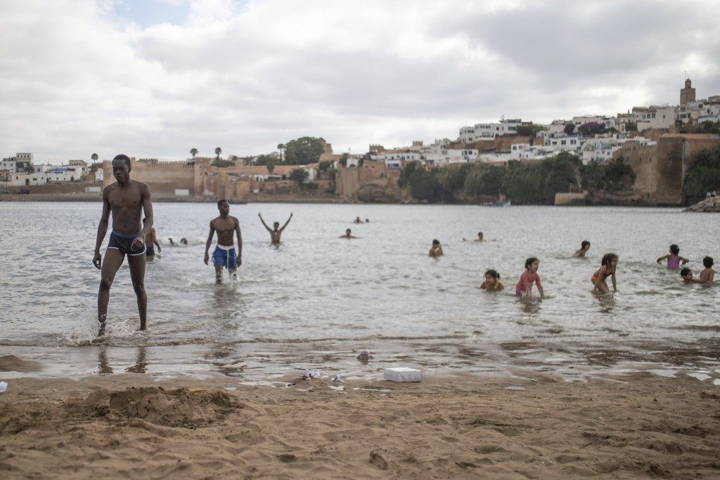 People gather at a reopened beach on the first weekend after lockdown measures were lifted in Sale, Morocco, Friday, June 26, 2020. (AP Photo/Mosa'ab ...