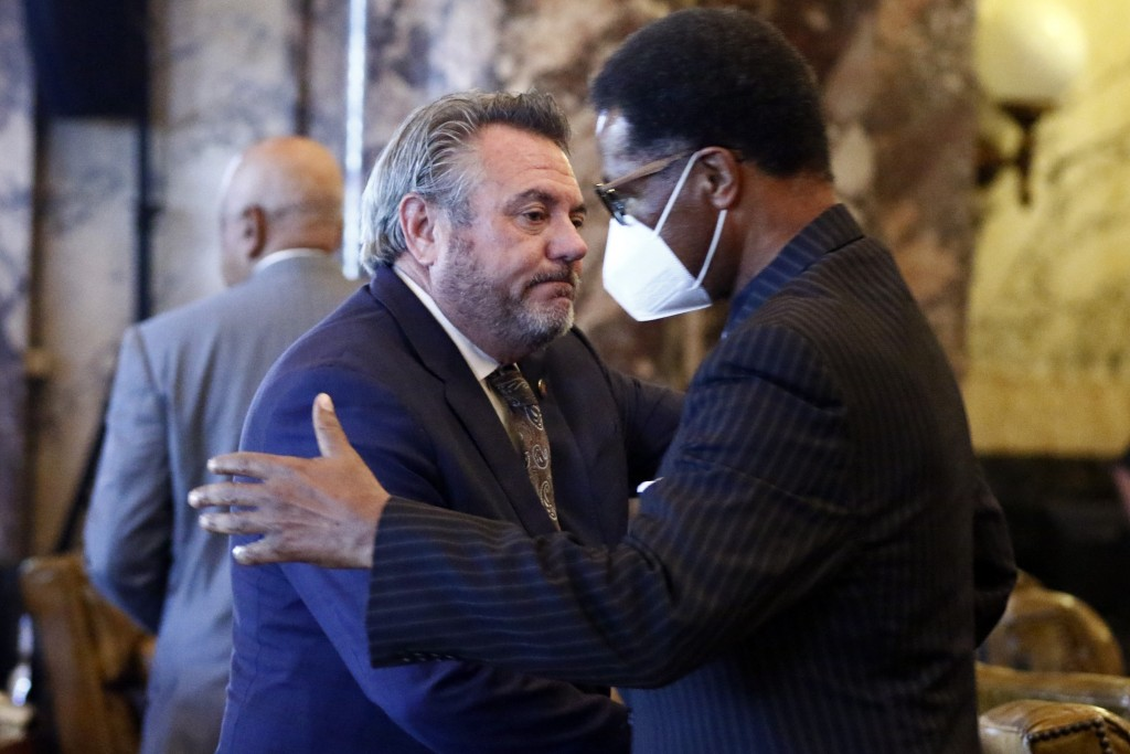 Sen. Michael McLendon, R-Hernando, congratulates Sen. Sollie Norwood, D-Jackson after the Senate voted to change the Mississippi state flag Sunday, Ju...