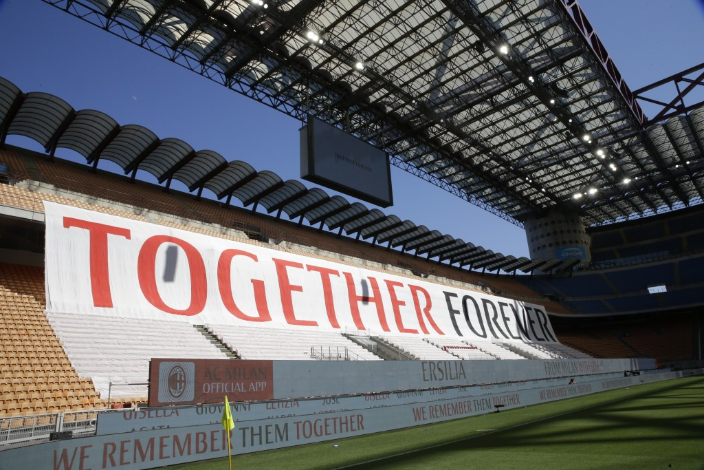 A giant banner is displayed during the Serie A soccer match between AC Milan and Roma, at the San Siro Stadium in Milan, Sunday, June 28, 2020. It was...