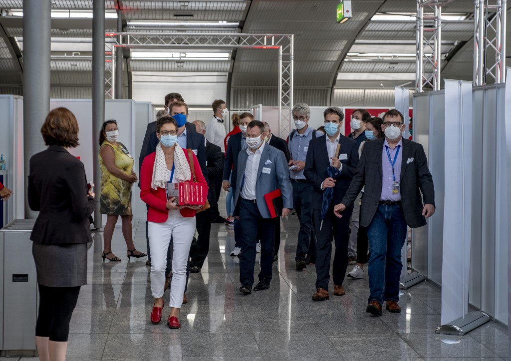 Media people visit the Corona test center at the airport in Frankfurt, Germany, Monday, June 29, 2020. In the future, people will be able to be tested...
