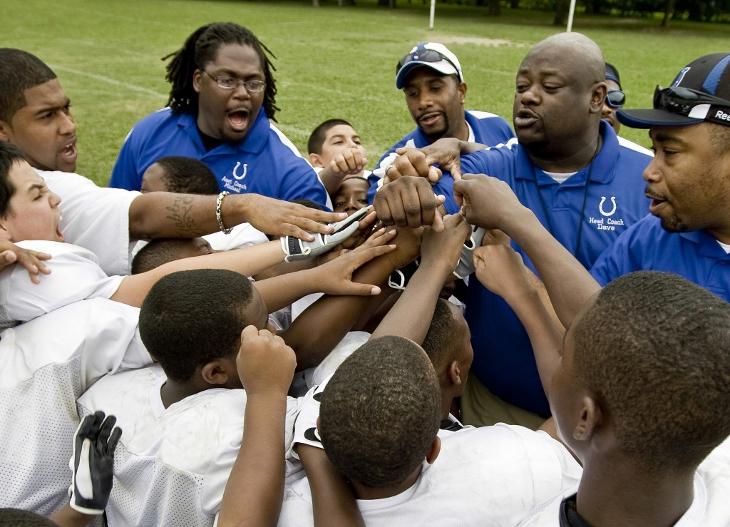 In this image provided by USA Football and taken June 29, 2009, a youth football team comes together at a practice in Dallas. USA Football has develop...