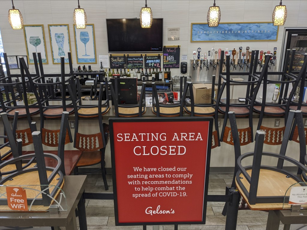 FILE - In this March 26, 2020, file photo, an indoors sitting bar is closed inside the Gelson's Market in Los Feliz neighborhood of Los Angeles. Gov. ...